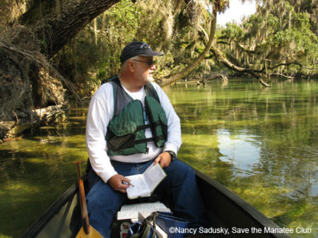 "Wayne Hartley takes ""manatee roll call"" at Blue Spring State Park."