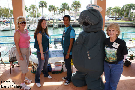 Manatee mascot and two student volunteer escorts at the Manatee Observation and Education Center stop for a photo opp with Kathleen Phillips (far right) and new Club volunteer Judi McCauley (far left) during NatureFest '09 in Fort Pierce, Florida. Save the Manatee Club volunteers staffed a manatee information table at the full-day festival, which had nearly 2000 visitors.