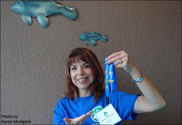 Save the Manatee Club volunteer Tracy McAlpine shows off her name tag lanyard.