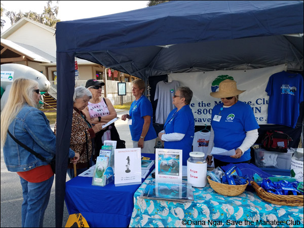 Save the Manatee Club volunteers chat with