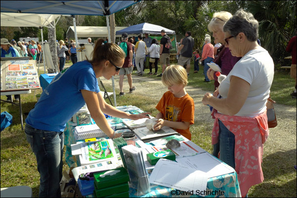 Cora Berchem gives out manatee information at Three Sisters Springs.