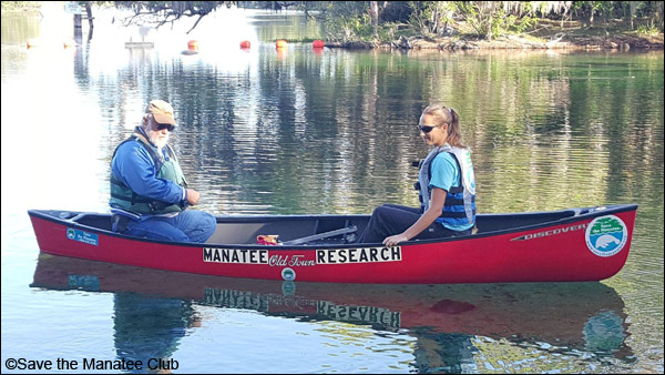Wayne Hartley, Manatee Specialist, and Cora Berchem, Manatee Research & Multimedia Specialist in the research canoe at Blue Spring State Park.