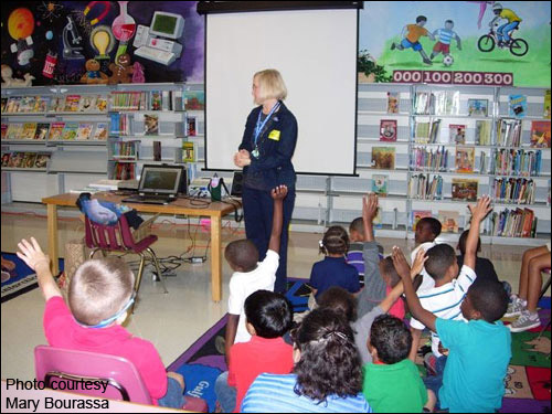Mary volunteers her time to give presentations about manatees at schools and summer camps.