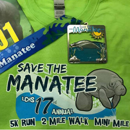 Save the Manatee 5K shirt and medal