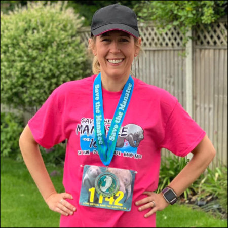 Fiona from London wears her Manatee 5K t-shirt and medal.