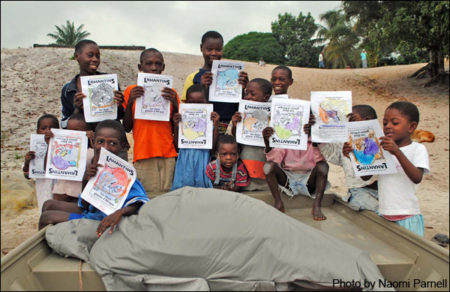 Children in West Africa with manatee coloring books produced by Save the Manatee Club.