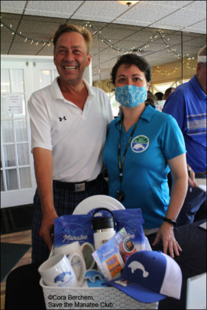 Raffle prize winner at the Save the Manatee Golf Tournament.